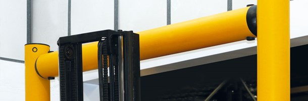 high level height restrictor for industrial doorway protection in warehouse