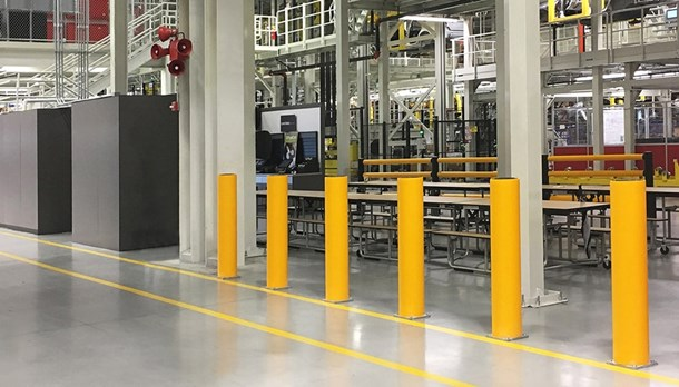 Industrial safety bollards protecting machines