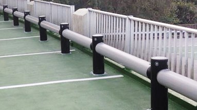 Car park safety guardrail protecting railings