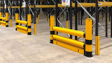 Industrial safety guardrail protecting warehouse assets