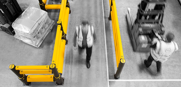 Workplace Safety Guide: Barriers protect people at a busy industrial facility