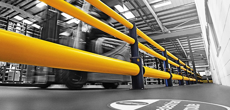 Workplace Safety Barriers: Barriers line a facility to segregate forklift trucks from machinery